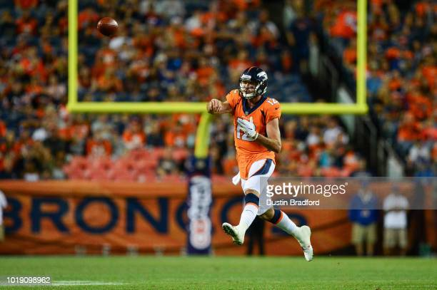 Quarterback Paxton Lynch of the Denver Broncos leaps and passes on the run in the fourth quarter during an NFL preseason game against the Chicago...