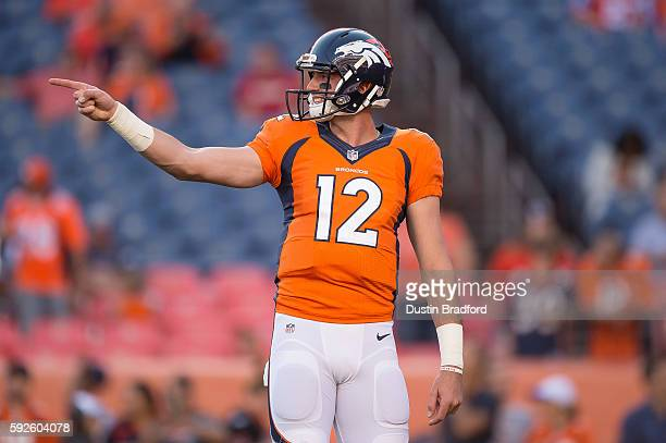 Quarterback Paxton Lynch of the Denver Broncos points down the field during player warm ups before a preseason NFL game against the San Francisco...