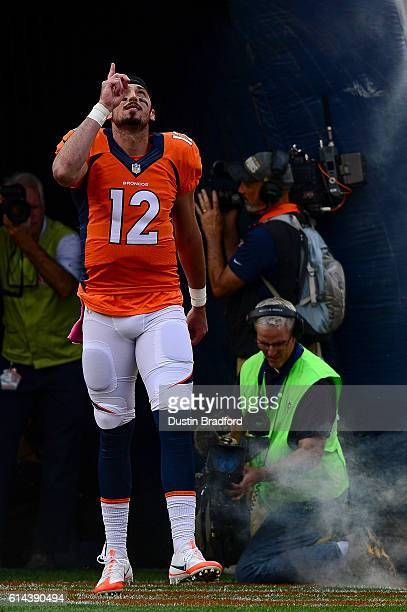 Quarterback Paxton Lynch of the Denver Broncos points to the sky as he walks onto the field during player introductions before his first career start...
