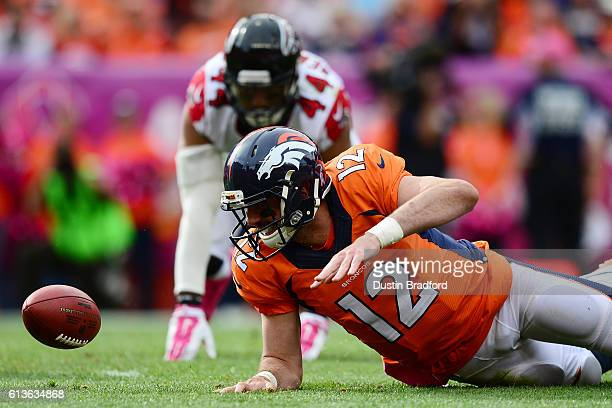 Quarterback Paxton Lynch of the Denver Broncos recovers his own fumble in the second quarter of the game against the Atlanta Falcons at Sports...