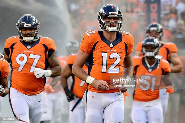 Quarterback Paxton Lynch of the Denver Broncos runs out of the tunnel before taking on the Carolina Panthers at Sports Authority Field at Mile High...