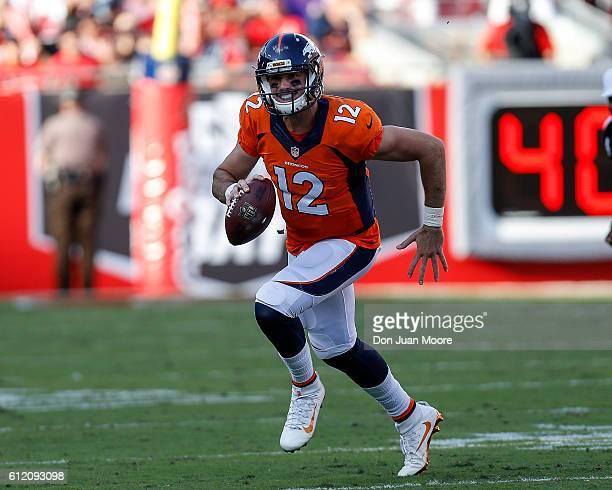Quarterback Paxton Lynch of the Denver Broncos runs out the passing pocket during the game against the Tampa Bay Buccaneers at Raymond James Stadium...