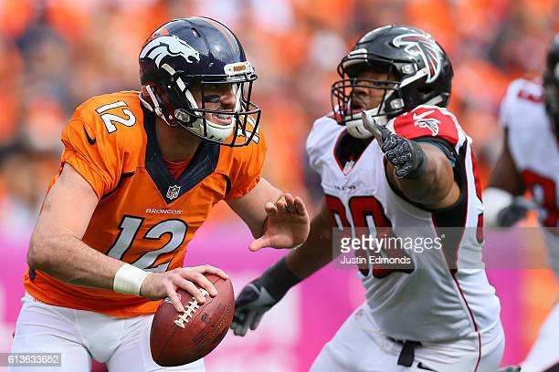 Quarterback Paxton Lynch of the Denver Broncos scrambles away from defensive end Derrick Shelby of the Atlanta Falcons in the first quarter of the...