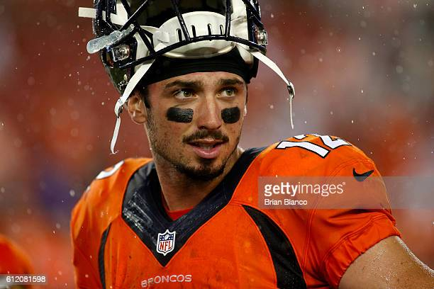 Quarterback Paxton Lynch of the Denver Broncos walks off the field in the rain following his 277 win over the Tampa Bay Buccaneers at the conclusion...