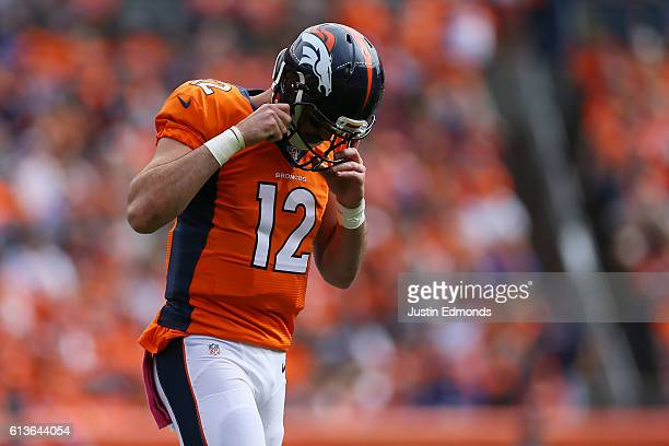 Quarterback Paxton Lynch of the Denver Broncos walks off the field in the first half of the game against the Atlanta Falcons at Sports Authority...