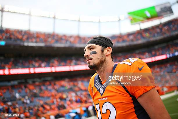 Quarterback Paxton Lynch of the Denver Broncos walks off the field after losing 2316 to the Atlanta Falcons at Sports Authority Field at Mile High on...