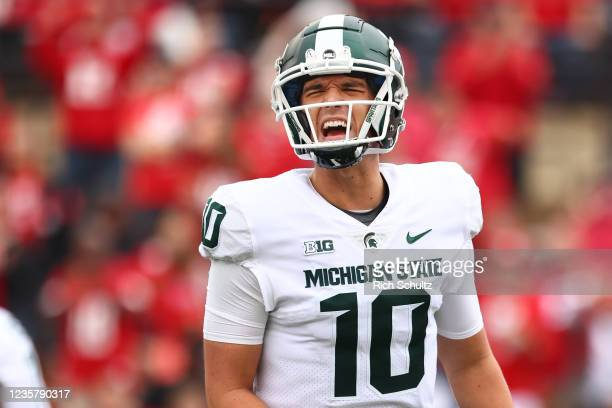 Quarterback Payton Thorne of the Michigan State Spartans reacts after a touchdown during the third quarter of a game against the Rutgers Scarlet...