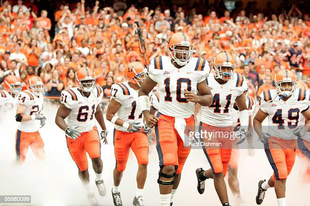 Quarterback Perry Patterson of the Syracuse University Orange leads the team out of the tunnel against the West Virginia University Mountaineers on...