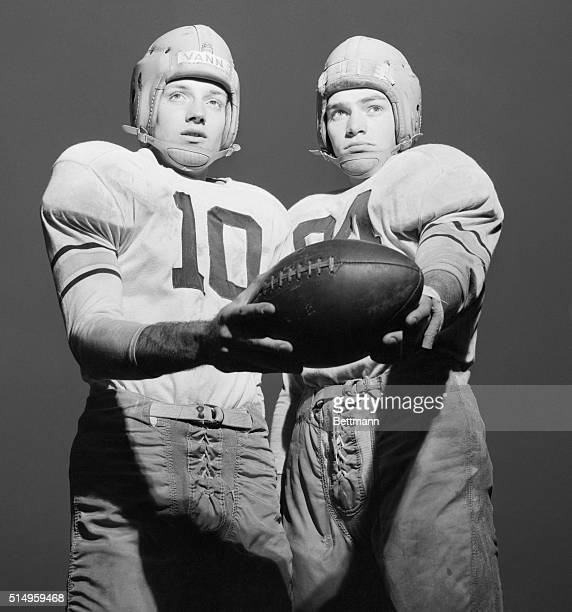 Quarterback Pete Vann of Hamburg, N.Y., shares the pigskin with Army teammate back Don Holleder of Webster, N.Y., symbolizing in a practice session...