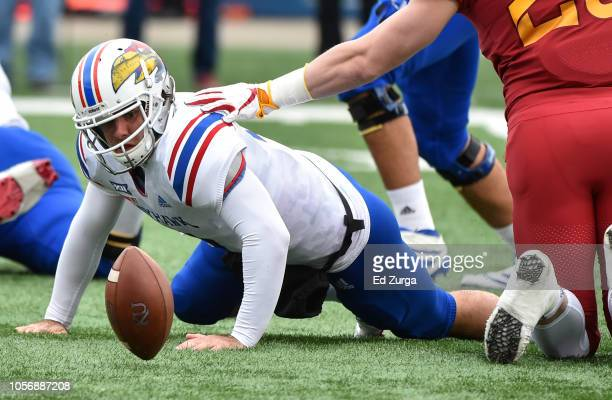 Quarterback Peyton Bender of the Kansas Jayhawks chases down a fumbled ball against the Iowa State Cyclones in the first quarter at Memorial Stadium...