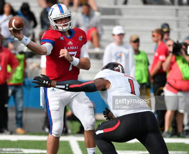 Quarterback Peyton Bender of the Kansas Jayhawks throws over linebacker Jordyn Brooks of the Texas Tech Red Raiders in the first quarter at Memorial...
