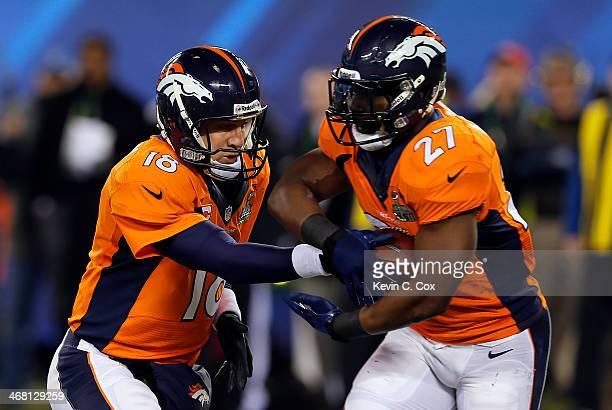 Quarterback Peyton Manning hand the ball off to running back Knowshon Moreno of the Denver Broncos during Super Bowl XLVIII at MetLife Stadium on...