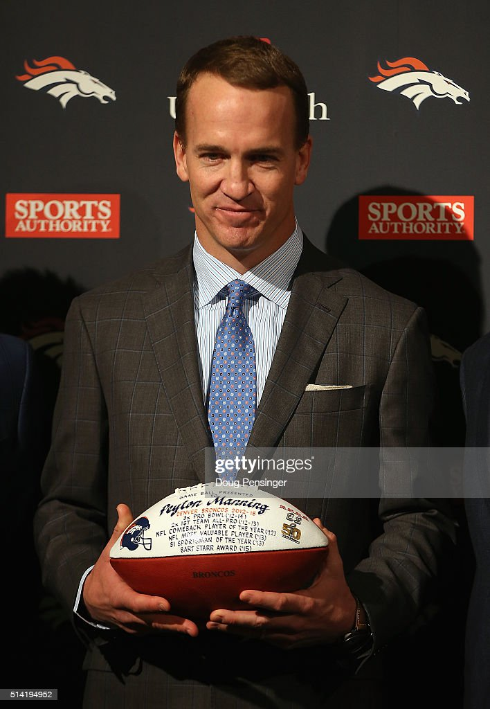 Quarterback Peyton Manning holds a game ball presented to him by the Denver Broncos after announcing his retirement from the NFL at the UCHealth Training Center on March 7, 2016 in Englewood, Colorado. Manning, who played for both the Indianapolis Colts and Denver Broncos in a career which spanned 18 years, is the NFL's all-time leader in passing touchdowns (539), passing yards (71,940) and tied for regular season QB wins (186). Manning played his final game last month as the winning quarterback in Super Bowl 50 in which the Broncos defeated the Carolina Panthers, earning Manning his second Super Bowl title.