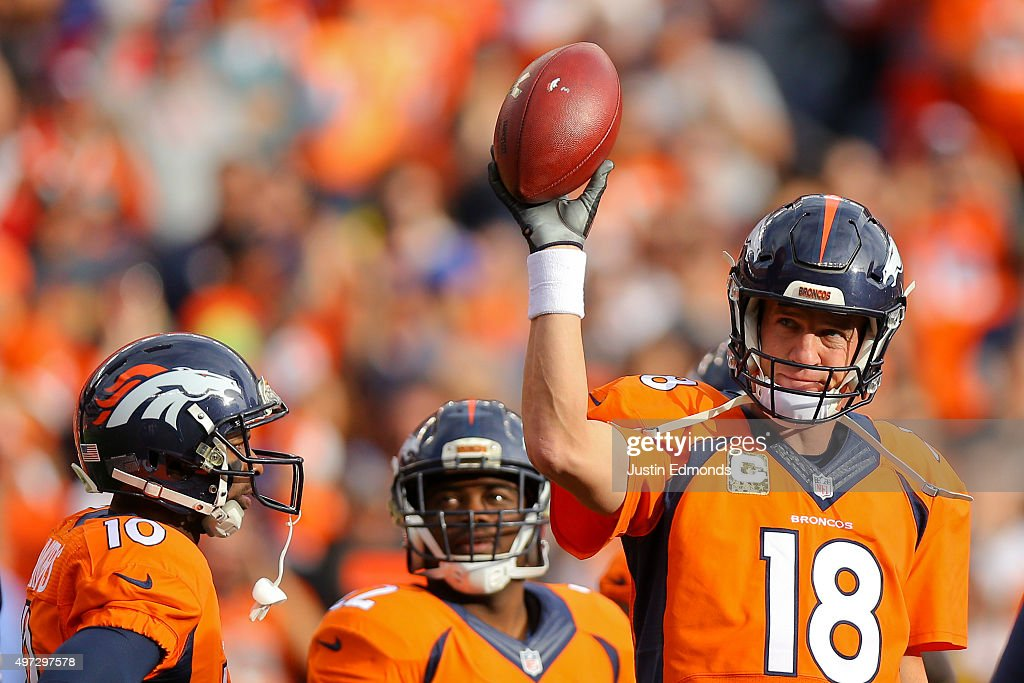 Quarterback Peyton Manning #18 of the Denver Broncos acknowledges the crowd after completing a pass for 4-yards to pass the all time career passing yards record during the first quarter against the Kansas City Chiefs at Sports Authority Field Field at Mile High on November 15, 2015 in Denver, Colorado. Mannning passes Bret Farve who previously held the record at 71, 838 yards.