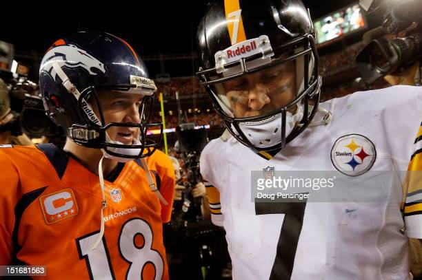 Quarterback Peyton Manning of the Denver Broncos and quarterback Ben Roethlisberger of the Pittsburgh Steelers meet at mid field after the Broncos...