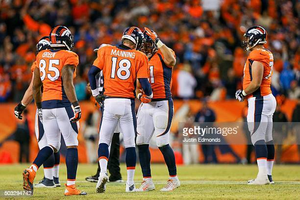 Quarterback Peyton Manning of the Denver Broncos celebrates with Owen Daniels after the Denver Broncos went ahead 2720 over the San Diego Chargers in...