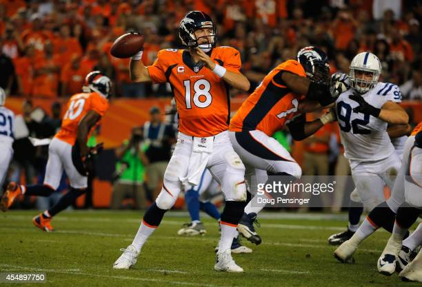 Quarterback Peyton Manning of the Denver Broncos delivers a five yard touchdown pass to tight end Julius Thomas of the Denver Broncos to take a 240...
