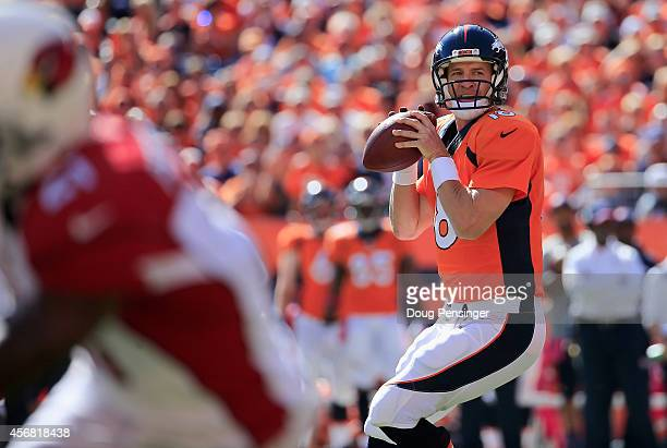 Quarterback Peyton Manning of the Denver Broncos delivers his 500th career touchdown pass to tight end Julius Thomas of the Denver Broncos in the...