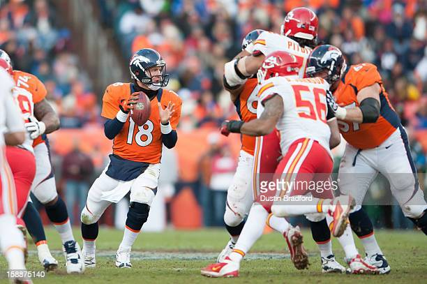Quarterback Peyton Manning of the Denver Broncos drops back to pass against the Kansas City Chiefs at Sports Authority Field at Mile High on December...
