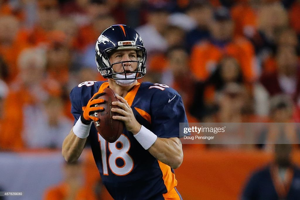 Quarterback Peyton Manning #18 of the Denver Broncos drops back to pass against the San Francisco 49ers during the first quarter of a game at Sports Authority Field at Mile High on October 19, 2014 in Denver, Colorado.