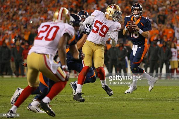 Quarterback Peyton Manning of the Denver Broncos drops back to throw his 509th career touchdown pass against the San Francisco 49ers during the...