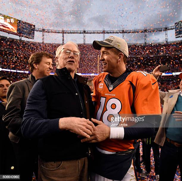 Quarterback Peyton Manning of the Denver Broncos gets a hug and is congratulated by his father Archie Manning after the Broncos defeated the Patriots...