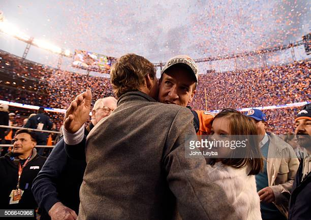 Quarterback Peyton Manning of the Denver Broncos gets a hug from brother Cooper Manning after the Broncos defeated the Patriots 20 to 18 winning the...