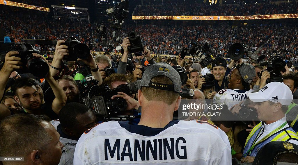 TOPSHOT - Quarterback Peyton Manning of the Denver Broncos is surrounded by the media following victory over the Carolina Panthers in Super Bowl 50 at Levi's Stadium in Santa Clara, California February 7, 2016. Peyton Manning clinched a fairytale second Super Bowl victory as the Denver Broncos produced an astonishing defensive display to defeat the Carolina Panthers 24-10. / AFP / TIMOTHY
