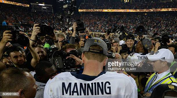 TOPSHOT Quarterback Peyton Manning of the Denver Broncos is surrounded by the media following victory over the Carolina Panthers in Super Bowl 50 at...