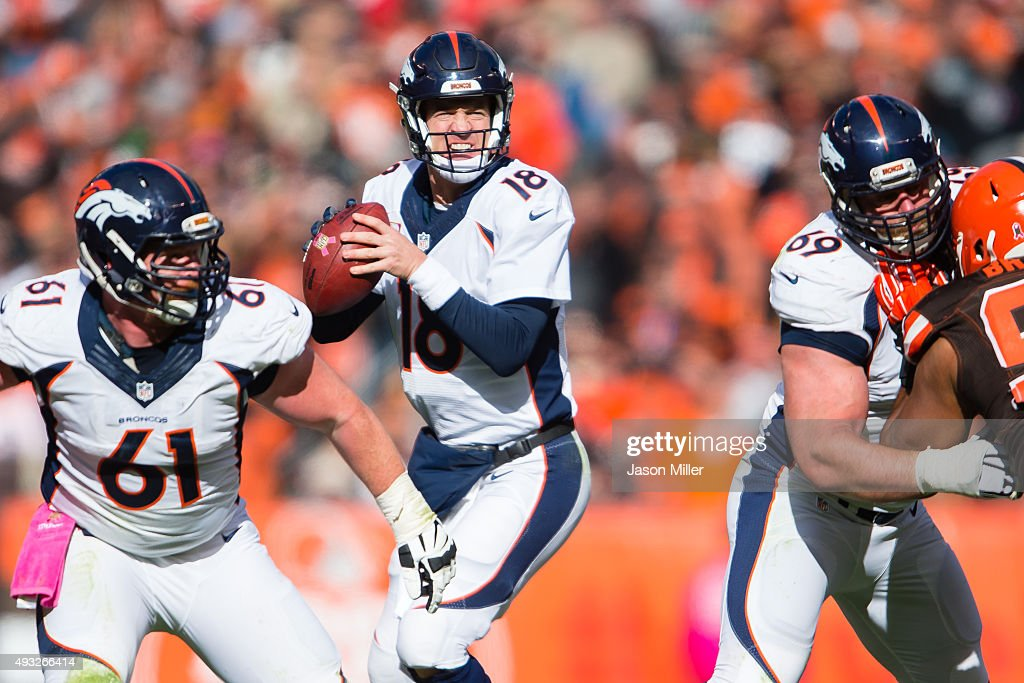 Quarterback Peyton Manning #18 of the Denver Broncos looks for a receiver during the second half against the Cleveland Browns at FirstEnergy Stadium on October 18, 2015 in Cleveland, Ohio. The Broncos defeated the Browns 26-23 in overtime.
