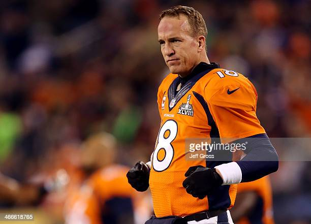 Quarterback Peyton Manning of the Denver Broncos looks on during warmups before playing against the Seattle Seahawks during Super Bowl XLVIII at...