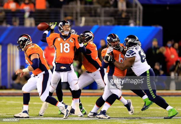 Quarterback Peyton Manning of the Denver Broncos looks to pass in the fourth quarter against the Seattle Seahawks during Super Bowl XLVIII at MetLife...