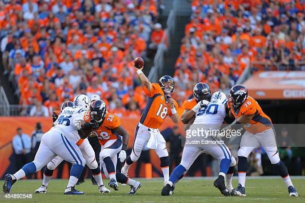 Quarterback Peyton Manning of the Denver Broncos passes against the Indianapolis Colts int he first quarter during a game at Sports Authority Field...