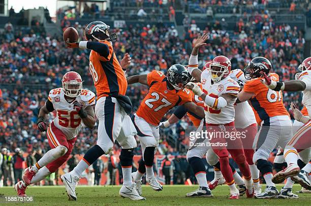 Quarterback Peyton Manning of the Denver Broncos passes and running back Knowshon Moreno blocks as inside linebacker Derrick Johnson and free safety...