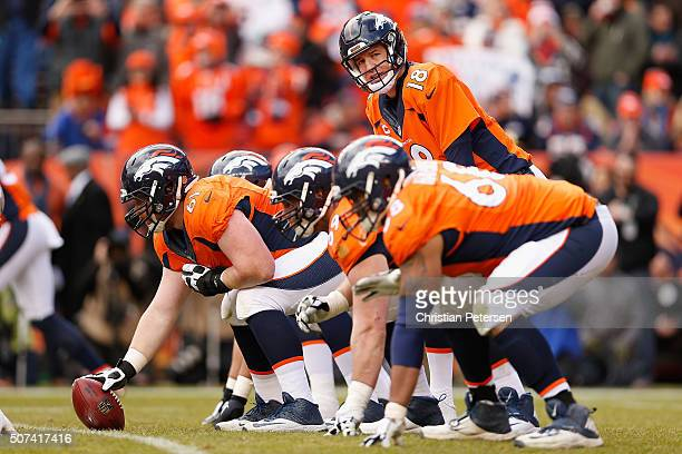 Quarterback Peyton Manning of the Denver Broncos prepares to snap the football during the AFC Championship game against the New England Patriots at...
