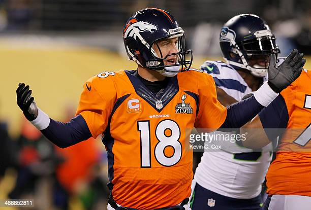 Quarterback Peyton Manning of the Denver Broncos reacts in the fourth quarter while taking on the Seattle Seahawks during Super Bowl XLVIII at...