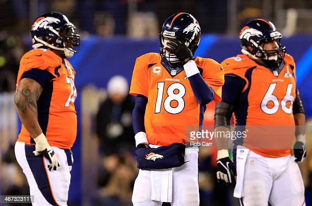Quarterback Peyton Manning of the Denver Broncos reacts in the fourth quarter against the Seattle Seahawks during Super Bowl XLVIII at MetLife...