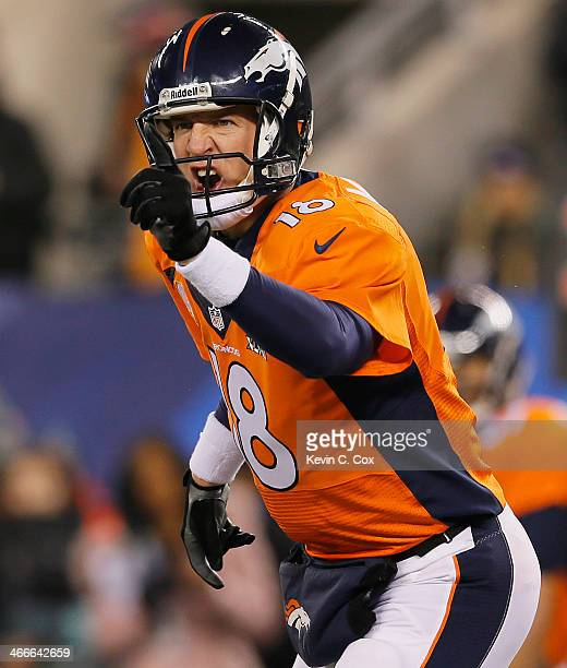 Quarterback Peyton Manning of the Denver Broncos reacts in the third quarter against the Seattle Seahawks during Super Bowl XLVIII at MetLife Stadium...