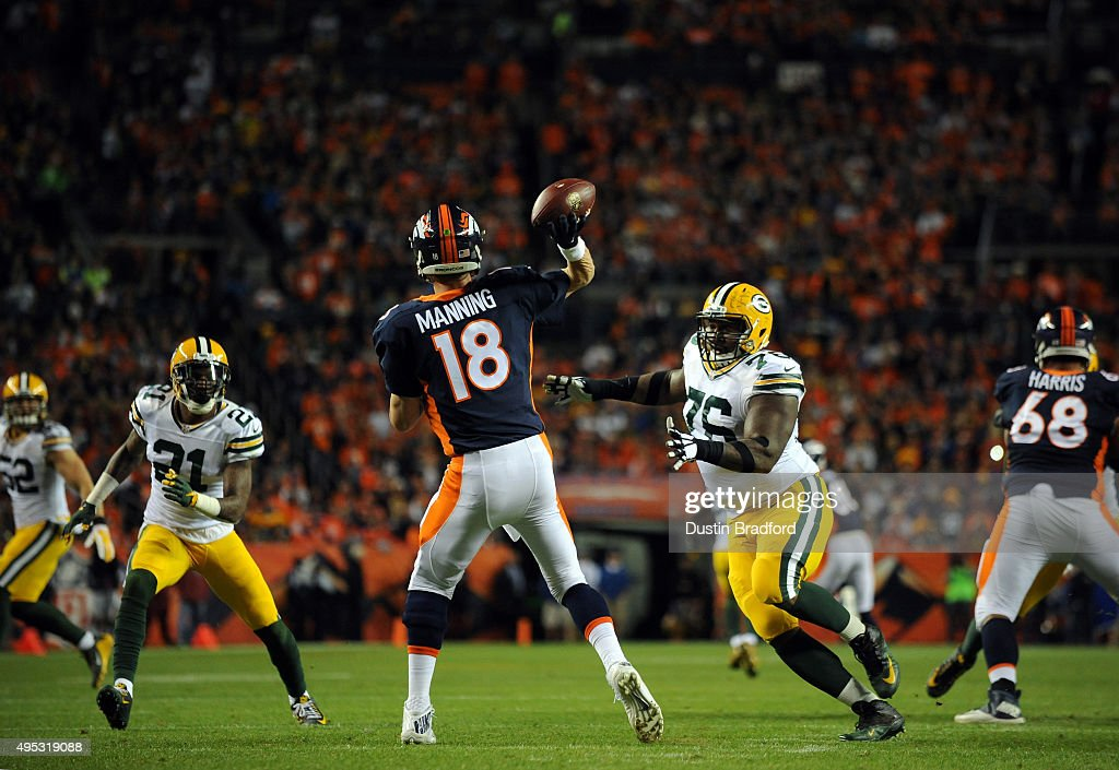 Quarterback Peyton Manning #18 of the Denver Broncos throws a pass against Mike Daniels #76 of the Green Bay Packers in the second half at Sports Authority Field at Mile High on November 1, 2015 in Denver, Colorado. The Broncos won 29-10.