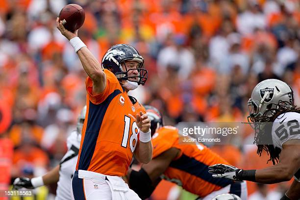 Quarterback Peyton Manning of the Denver Broncos throws a pass against the Oakland Raiders at Sports Authority Field Field at Mile High on September...