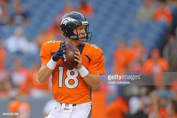 Quarterback Peyton Manning of the Denver Broncos throws as he warms up before a preseason game at Sports Authority Field at Mile High on August 23...