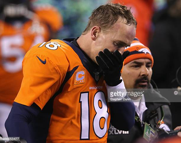 Quarterback Peyton Manning of the Denver Broncos walks off the field after their 438 loss to the Seattle Seahawks during Super Bowl XLVIII at MetLife...