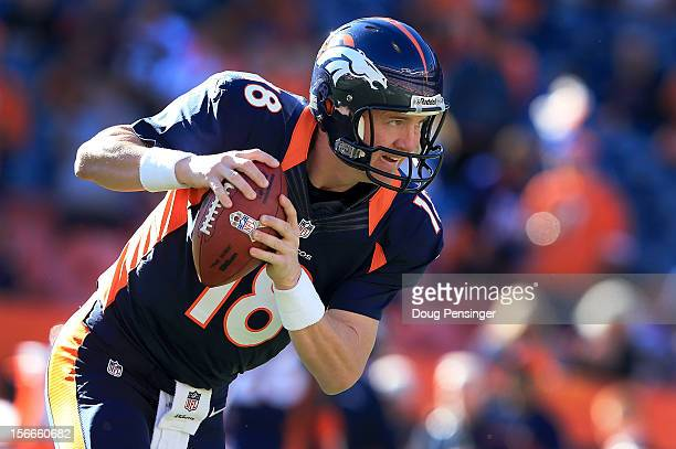 Quarterback Peyton Manning of the Denver Broncos warms up prior to facing the San Diego Chargers at Sports Authority Field at Mile High on November...