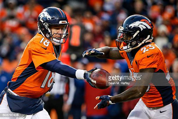 Quarterback Peyton Manning of the Denver Broncos who entered the game after Brock Osweiler sustained an injury hands off to running back Ronnie...