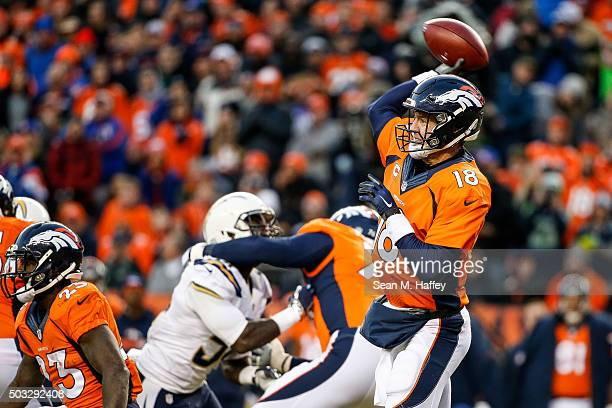 Quarterback Peyton Manning of the Denver Broncos who entered the game after Brock Osweiler sustained an injury passes against the San Diego Chargers...