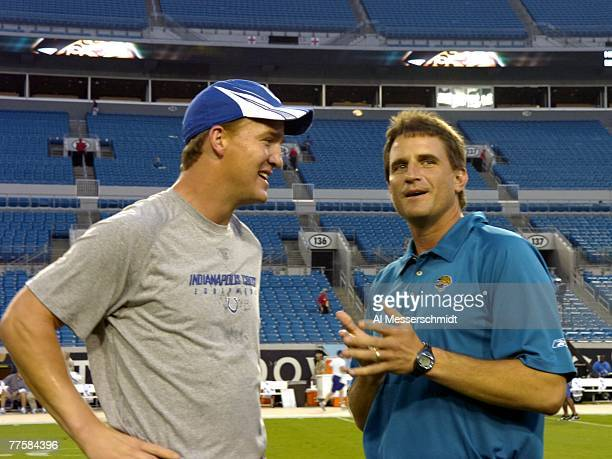 Quarterback Peyton Manning of the Indianapolis Colts and quarterbacks coach Mike Shula of the Jacksonville Jaguars talk before play at the...