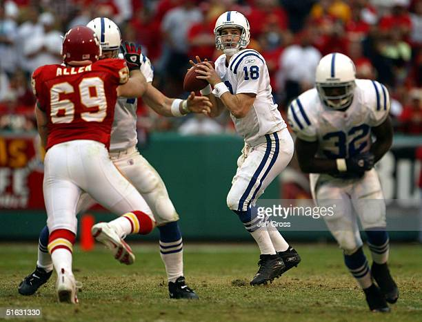 Quarterback Peyton Manning of the Indianapolis Colts drops back to pass against the Kansas City Chiefs on October 31 2004 at Arrowhead Stadium in...