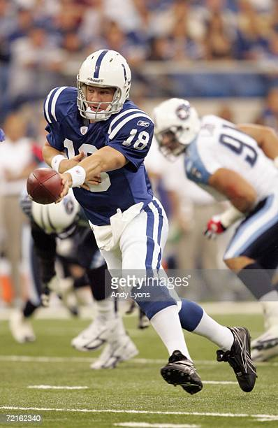 Quarterback Peyton Manning of the Indianapolis Colts hands off the ball during the NFL game against the Tennessee Titans at the RCA Dome on October...
