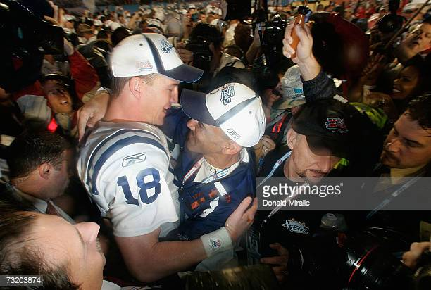 Quarterback Peyton Manning of the Indianapolis Colts hugs head coach Tony Dungy as they celebrate their 2917 win against the Chicago Bears in Super...
