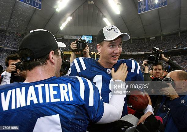 Quarterback Peyton Manning of the Indianapolis Colts is congratulated by teammate Adam Vinatieri after their team defeated the New England Patriots...